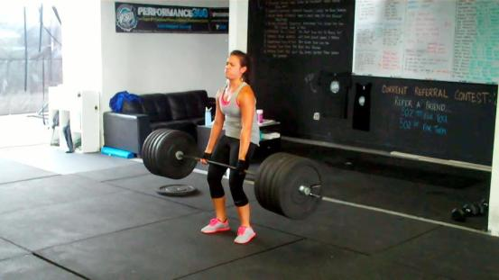 Alex with 265# on the bar. She literally did not know what a deadlift was when she first started.